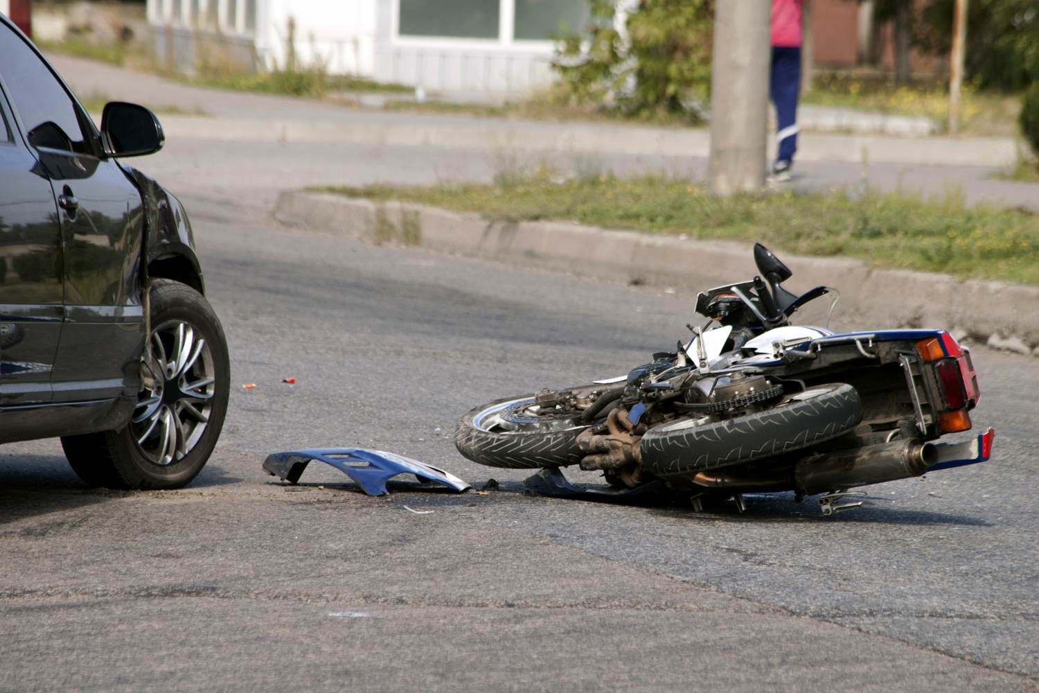 Motorcycle crash with black car