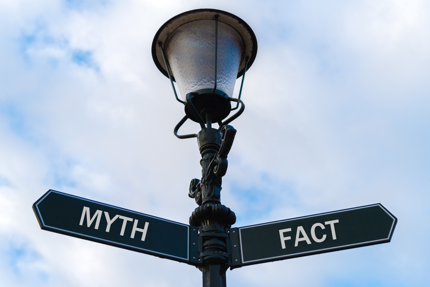 Myth versus Fact directional signs on guidepost
