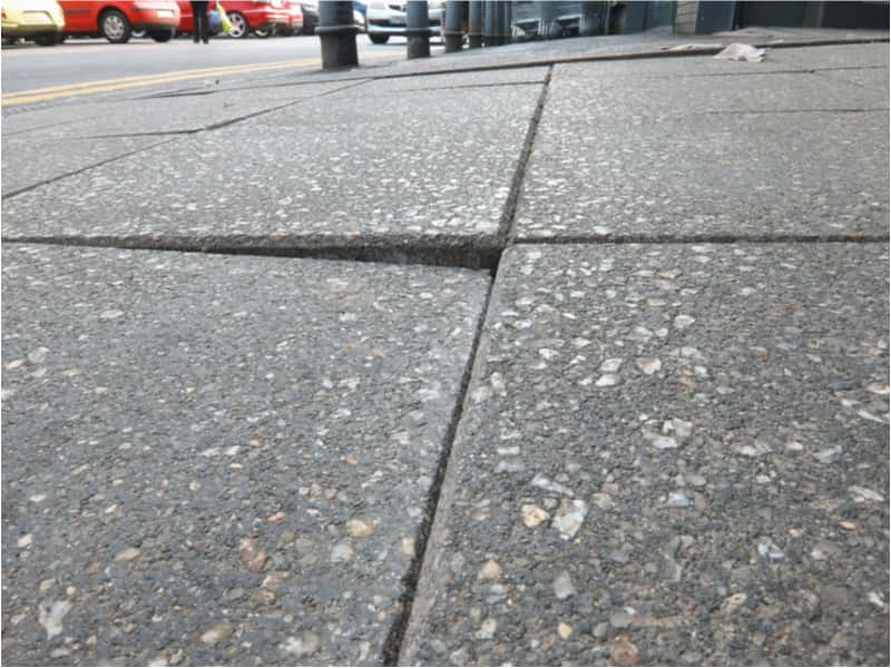 tripping over a loose paving slab